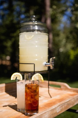 glass-dispenser-with-spout-filled-with-fresh-lemonade