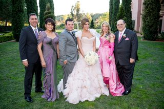 bride-in-mark-zunino-ruffle-wedding-dress-with-mother-of-bride-in-bright-pink-gloves-and-groom