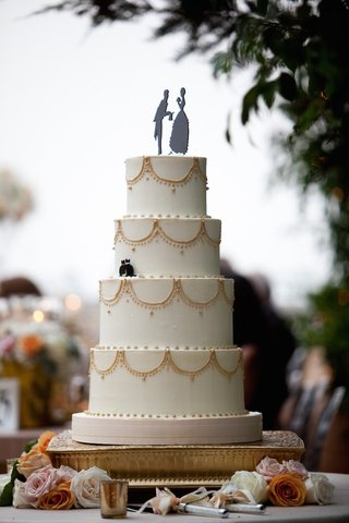 simple-white-cake-with-gold-piping-and-whimsical-topper