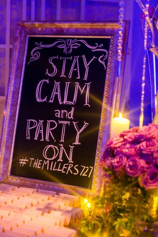 stay-calm-and-party-on-sign-with-hashtag-at-escort-card-table