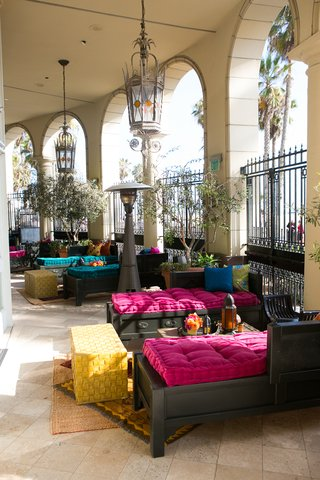 moroccan-themed-engagement-party-with-hot-pink-blue-cushions-bright-throw-pillows-casa-del-mar