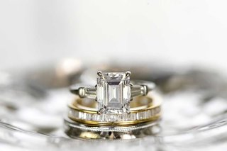emerald-cut-diamond-engagement-ring-with-tapered-baguette-diamond-side-stones-gold-eternity-band