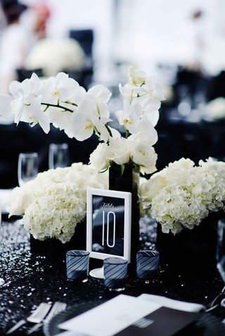 white-frame-with-table-number-on-black-stationery-at-wedding