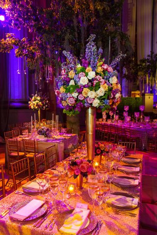 purple-and-pink-lighting-on-gold-tablescape