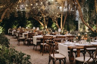 wedding-reception-rustic-wood-tables-linen-runner-short-centerpieces-vibiana-redbird-venue