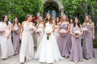 bride-in-vera-wang-wedding-dress-with-bridesmaids-in-light-purple-dresses-and-light-pink-bouquets