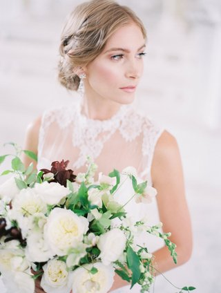 bride-in-a-jinza-couture-bridal-dress-with-chantilly-lace-updo-bouquet-of-white-flowers-greenery