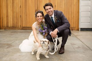 bride-in-a-line-wedding-dress-groom-in-suit-with-white-small-tog-white-leash-wedding-pet-in-ceremony