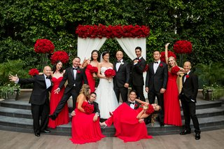 bride-in-liancarlo-bridesmaids-in-strapless-red-dresses-groom-in-armani-groomsmen-in-tuxedos