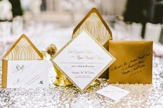 olive-paper-gold-wedding-invitation-suite-on-silver-sequin-tablecloth