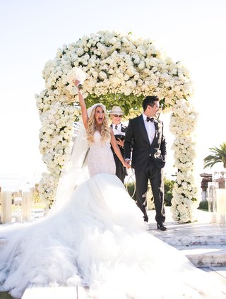 bride-in-galia-lahav-mermaid-wedding-dress-with-groom-after-being-pronounced-husband-and-wife-arch