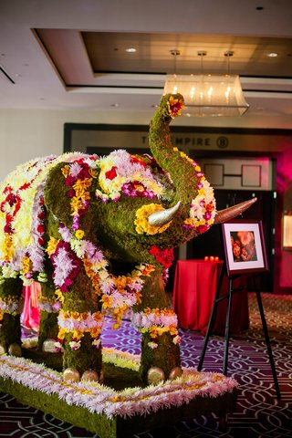 moss-and-flower-covered-elephant-on-display