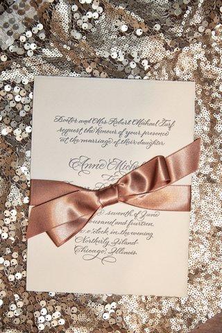 cream-wedding-invitation-with-script-font-and-copper-bow