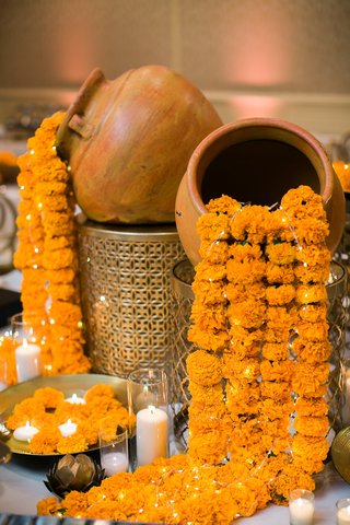 hindu-wedding-traditional-decor-with-marigolds-and-lights-spilling-from-pots