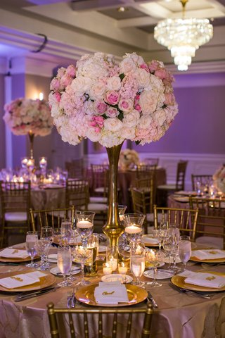 blush-and-ivory-floral-centerpiece-on-gold-stand-purple-uplighting-ballroom-reception