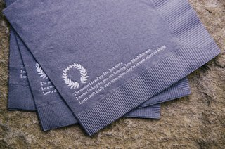 gray-napkins-with-poem-printed-on-them
