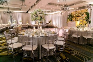 silver-ivory-color-scheme-ballroom-wedding-reception-four-seasons-washington-dc-tall-floral-lights
