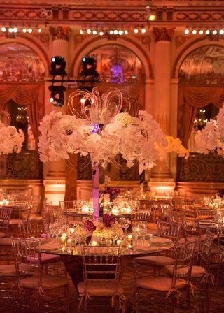 clear-chiavari-chairs-around-mirror-top-round-table-with-orchid-centerpiece-lucite-mirror-details