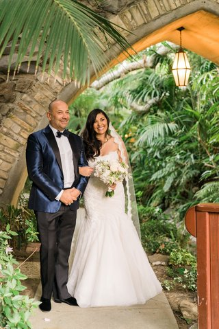bride-in-mermaid-monique-lhuillier-wedding-dress-and-lace-trim-veil-with-celio-in-blue-suit-jacket
