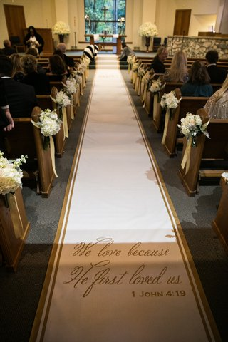 aisle-runner-with-gold-trim-and-1-john-4-19-verse-on-aisle-runner