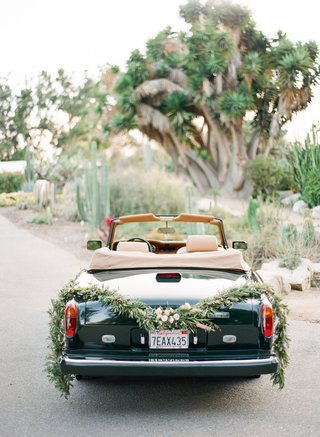 1980s-rolls-royce-convertible-getaway-car-with-garland-of-greenery-and-succulents