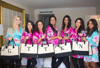bridesmaids-in-silk-floral-robes-hold-monogrammed-tote-bags-bridesmaids-gift