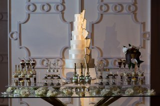 spotlighted-cake-on-center-of-dessert-table
