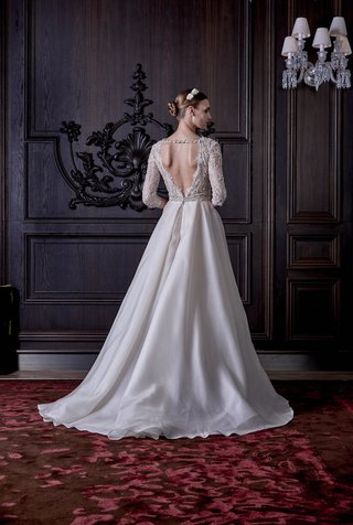 open-back-of-ball-gown-with-long-lace-sleeves-by-monique-lhuillier