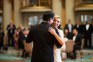bride-in-a-jenny-packham-dress-dances-with-groom-in-a-black-tuxedo