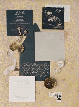 destination-wedding-invitation-suite-black-card-stock-with-gold-calligraphy-map-and-monogram