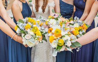 bridesmaid-and-bridal-bouquet-marigold-flowers-greenery-white-roses-wedding-flowers