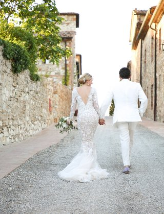 bride-in-marchesa-wedding-dress-long-sleeves-v-back-mermaid-groom-in-white-tuxedo-tuscan-road