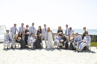 couple-with-bridesmaids-and-groomsmen-on-sand