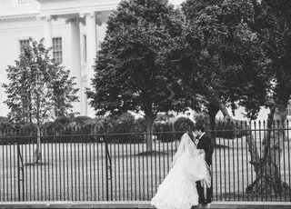 black-and-white-photo-of-bride-and-groom-kissing