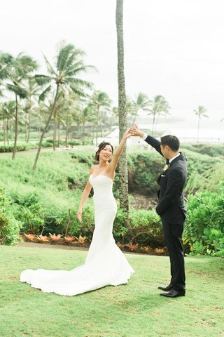 wedding-portrait-bride-in-strapless-wedding-dress-being-spun-by-groom-in-tuxedo-suit-hawaii-maui