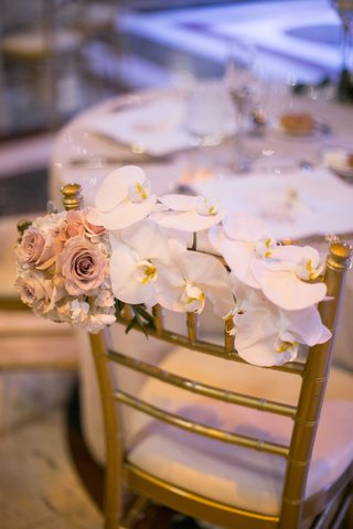 reception-chair-floral-adornment-orchids-roses-decoration-back-of-wedding-feminine-touch-wedding