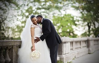 bride-in-legends-romona-keveza-gown-with-illusion-neckline-groom-in-jos-a-bank-tux-kisses-neck