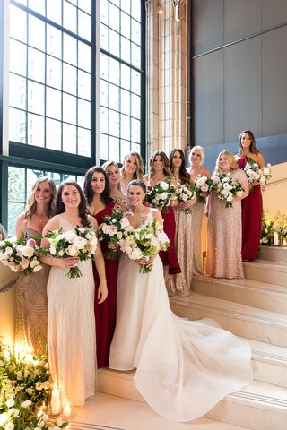 bride-with-bridesmaids-in-mismatched-bridesmaid-dresses-assorted-styles-colors-and-materials
