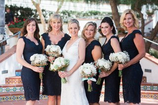 bride-in-a-sleeveless-claire-pettibone-dress-bridesmaids-in-short-lace-blue-tadashi-shoji-dresses