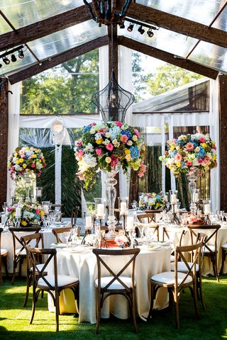 wedding-reception-wood-tent-clear-white-colorful-tall-centerpiece-designs-wood-chairs