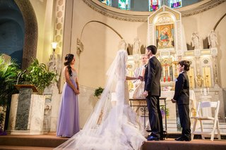 bride-in-vera-wang-wedding-dress-with-groom-at-altar-of-the-shrine-of-our-lady-of-pompeii