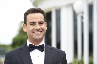 man-wearing-tuxedo-and-black-bow-tie