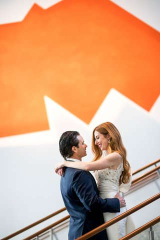 bride-with-long-beautiful-red-hair-and-groom-with-slicked-back-hair-wedding-portrait