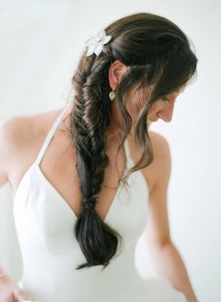 bride-with-white-v-neck-vera-wang-halter-gown-with-brown-hair-fishtail-braid-flower-hair-accessory