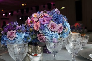 small-floral-arrangement-with-pink-purple-and-blue-on-round-white-reception-table