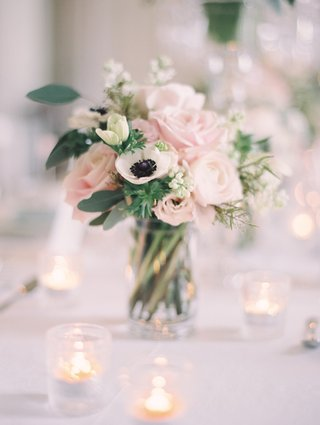 wedding-reception-table-with-bouquet-of-blush-roses-ivory-anemones-and-greenery