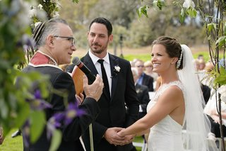 melissa-claire-egan-and-husband-at-outdoor-wedding-ceremony