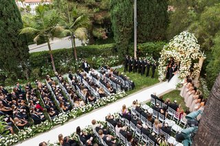 guests-sitting-down-for-outdoor-beverly-hills-hotel-wedding-ceremony-aisle-runner-chuppah-palm-trees
