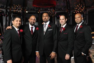 indian-man-with-friends-in-tuxedos-at-reception