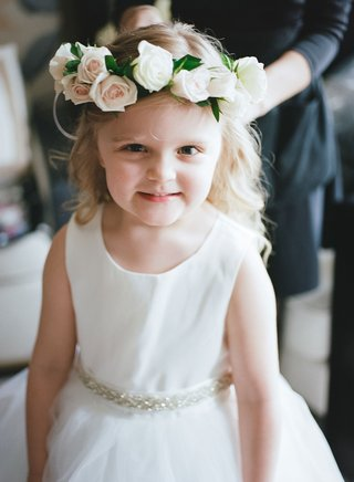 flower-girl-in-white-dress-curled-blonde-hair-flower-grown-with-pink-white-roses-and-greenery